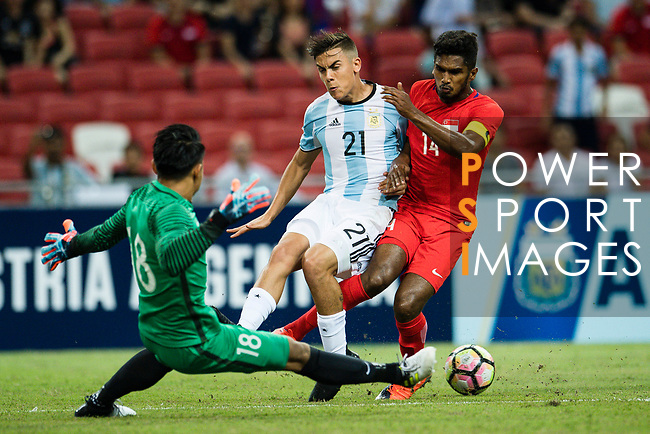 Paulo Dybala of Argentina (C) trips up with Hassan Sunny of Singapure (L) during the International Test match between Argentina and Singapore at National Stadium on June 13, 2017 in Singapore. Photo by Marcio Rodrigo Machado / Power Sport Images