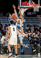 WASHINGTON, DC - FEBRUARY 05: Jared Rhoden #14 of Seton Hall shoots over Omer Yurtseven #44 of Georgetown during a game between Seton Hall and Georgetown at Capital One Arena on February 05, 2020 in Washington, DC.