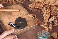 Cuba, Pinar del Rio Region, Viñales (Vinales) Area.  A torcedor's (cigar roller's) work place.