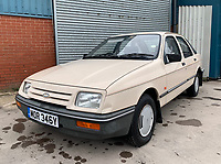BNPS.co.uk (01202 558833)<br /> Pic: HampsonAuctions/BNPS<br /> <br /> Pictured: 1983 Ford Sierra 1.6 L.<br /> <br /> Since the 1990s, Geoff Barlow, 46, has collected dozens of classic cars from an Escort Mexico replica to several types of Transit, Cortina, and Sierra.<br /> <br /> However, he still regrets selling the first car which inspired his passion, a 1980 Escort Mark 2 he bought from his sister in 1992.  <br /> <br /> Geoff's fascination with Fords gathered pace in the last decade and he 'lost control,' buying as many Fords as he came across and saving them from disrepair.