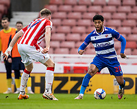 6th February 2021; Bet365 Stadium, Stoke, Staffordshire, England; English Football League Championship Football, Stoke City versus Reading; Josh Laurent of Reading under pressure from Nathan Collins of Stoke City