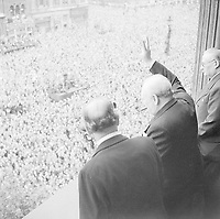 hurchill waves to crowds in Whitehall on the day he broadcast to the nation that the war with Germany had been won, 8 May 1945 (VE Day).