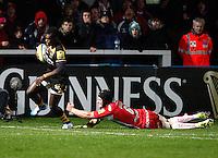 Photo: Richard Lane/Richard Lane Photography. Gloucester Rugby v London Wasps. Aviva Premiership. 02/11/2013 Wasps' Christian Wade breaks past Gloucester's Tom Savage for a try.