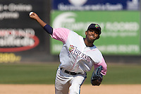August 30, 2009: Everett AquaSox pitcher Fray Martinez toes the rubber against the Salem-Keizer Volcanoes during a Northwest League game at Everett Memorial Stadium in Everett, Washington.  The AquaSox wore pink jerseys for breast cancer awareness.