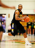 30 January 2010: University at Albany Great Danes' guard Tim Ambrose, a Junior from Brentwood, NY, in action against the University of Vermont Catamounts at Patrick Gymnasium in Burlington, Vermont. The Catamounts defeated the Danes 64-46 in the America East matchup. Mandatory Credit: Ed Wolfstein Photo