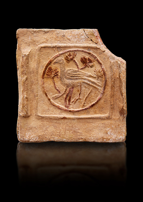 6th-7th Century Eastern Roman Byzantine  Christian Terracotta tiles depicting a bird - Produced in Byzacena -  present day Tunisia. <br /> <br /> These early Christian terracotta tiles were mass produced thanks to moulds. Their quadrangular, square or rectangular shape as well as the standardised sizes in use in the different regions were determined by their architectonic function and were designed to facilitate their assembly according to various combinations to decorate large flat surfaces of walls or ceilings. <br /> <br /> Byzacena stood out for its use of biblical and hagiographic themes and a richer variety of animals, birds and roses. Some deer and lions were obviously inspired from Zeugitana prototypes attesting to the pre-existence of this province's production with respect to that of Byzacena. The rules governing this art are similar to those that applied to late Roman and Christian art with, in the case of Byzacena, an obvious popular connotation. Its distinguishing features are flatness, a predilection for symmetrical compositions, frontal and lateral representations, the absence of tridimensional attitudes and the naivety of some details (large eyes, pointed chins). Mass production enabled this type of decoration to be widely used at little cost and it played a role as ideograms and for teaching catechism through pictures. Painting, now often faded, enhanced motifs in relief or enriched them with additional details to break their repetitive monotony.<br /> <br /> The Bardo National Museum Tunis, Tunisia.  Against a black background.