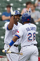 Round Rock Express outfielder Joey Butler #16 is greeted by teammate Yangervis Solarte #26 after he hit a home run against the New Orleans Zephyrs in the Pacific Coast League baseball game on April 21, 2013 at the Dell Diamond in Round Rock, Texas. Round Rock defeated New Orleans 7-1. (Andrew Woolley/Four Seam Images).
