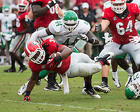 The Georgia Bulldogs played North Texas Mean Green at Sanford Stadium.  After North Texas tied the game at 21 early in the second half, the Georgia Bulldogs went on to score 24 unanswered points to win 45-21.  Georgia Bulldogs running back Todd Gurley (3) reaches for the extra yard.
