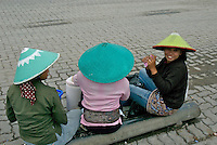 Women workers having a rest chatting in the street leading to the  Jakarta Harbor, Indonesia