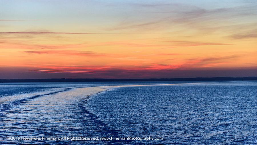 Sunset and ships wake