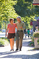 Couple strolls down Main Street, Moorestown, New Jersey
