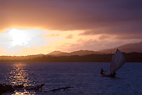 Sunrise as a fisherman heads out for the day, Comarca De Kuna Yala, San Blas Islands, Panama