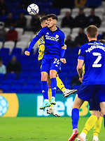 28th September 2021; Cardiff City Stadium, Cardiff, Wales;  EFL Championship football, Cardiff versus West Bromwich Albion; Ryan Giles of Cardiff City jumps to win the ball in front of the West Bromwich Albion defender