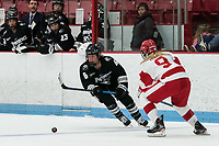 BOSTON, MA - JANUARY 11: Bailey Burton #6 of Providence College brings the puck forward as Abby Cook #9 of Boston University defends during a game between Providence College and Boston University at Walter Brown Arena on January 11, 2020 in Boston, Massachusetts.