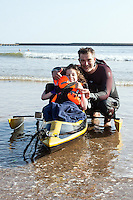 COPY BY TOM BEDFORD<br /> Pictured: Poppy Jones and her dad Rob testing out the special boat for the triathlon.<br /> Re: A very special father-and-daughter team have tackled the Cardiff Triathlon on Sunday 26 June 2016.<br /> Poppy Jones, 11, who will be competing alongside dad Rob Jones, wants to win the event.<br /> And she's not going to let the fact that she has quadriplegic cerebral palsy , which means she can't sit, stand, roll or support herself, and chronic lung disease stop her.<br /> She will be by Rob's side every step of the way thanks to a cutting-edge wheelchair and boat – for Rob to push or pull – designed especially for the event, which sees participants take part in a swim across Cardiff Bay , a run and a bike ride.