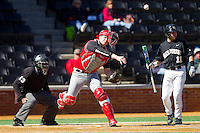 Youngstown State Penguins catcher Josh White (17) makes a throw to first base against the Wake Forest Demon Deacons at Wake Forest Baseball Park on February 24, 2013 in Winston-Salem, North Carolina.  The Demon Deacons defeated the Penguins 6-5.  (Brian Westerholt/Four Seam Images)