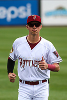 Wisconsin Timber Rattlers first baseman Chad McClanahan (22) warms up in the outfield prior to a game against the Cedar Rapids Kernels on September 8, 2021 at Neuroscience Group Field at Fox Cities Stadium in Grand Chute, Wisconsin.  (Brad Krause/Four Seam Images)