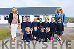 The eleven new Juniors who stared School in Scoil Bhréanainn, Portmagee on Monday pictured here with back l-r; Marian Kelly & Denise Coffey(Teacher).