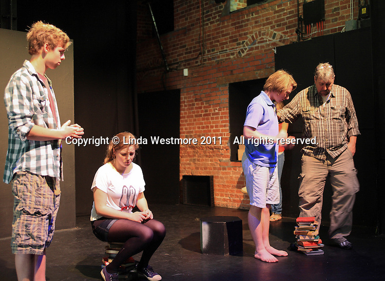 """The Yvonne Arnaud Youth Theatre rehearsing """"The Lion, the Witch and the Wardrobe"""", Guildford, Surrey.  Adam Forde, Director, on the right."""