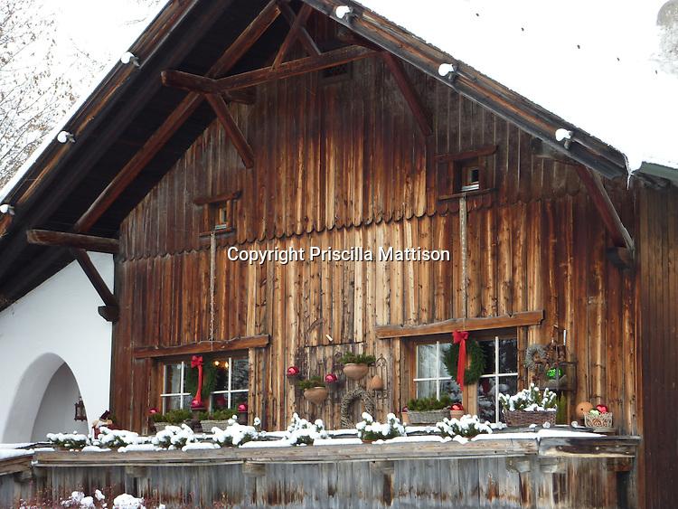 Seefeld, Austria - December 12, 2009: A wood chalet wears festive Christmas decorations.