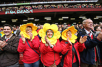 Pictured: Three female welsh supporters wearing daffodil heads Saturday 14 March 2015<br />