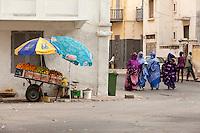Senegal, Saint Louis.  Women Walking and Talking.