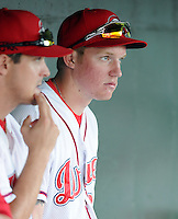 Ryan Westmoreland (24) of the Greenville Drive watches the game from the dugout at a game on Sept. 5, 2010, at Fluor Field at the West End in Greenville, S.C. Westmoreland, once a Top 10 prospect in the Red Sox organiztion, had surgery in March to remove a cavernous malformation on his brain stem, and faces a difficult recovery. He is not yet playing, but is working out with the Drive as part of his rehabilitation. Photo by: Tom Priddy/Four Seam Images
