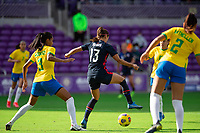 ORLANDO CITY, FL - FEBRUARY 21: Alex Morgan #13 of the USWNT battles for the ball during a game between Brazil and USWNT at Exploria Stadium on February 21, 2021 in Orlando City, Florida.