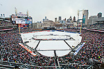 31 December 2013: A overview of the ice rink and stadium with the Detroit skyline, during the Toronto Maple Leafs v Detroit Red Wings Alumni Showdown hockey game, at Comerica Park, in Detroit, MI.