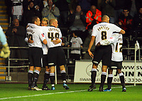 ATTENTION SPORTS PICTURE DESK<br /> Pictured: (L-R) Lee Trundle, Gorka Pintado, David Cotterill, Darren Pratley and Nathan Dyer of Swansea City celebrate <br /> Re: Coca Cola Championship, Swansea City Football Club v Plymouth Argyle at the Liberty Stadium, Swansea, south Wales. Tuesday 08 December 2009