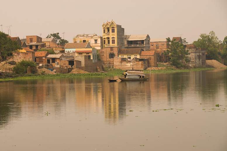 Houses and the river surrounding of the village of Tho Ha in Northern Vietnam.