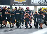 Sep 2, 2018; Clermont, IN, USA; Leah Pritchett (center) and crew members watch as NHRA top alcohol funny car driver Gary Pritchett during qualifying for the US Nationals at Lucas Oil Raceway. Mandatory Credit: Mark J. Rebilas-USA TODAY Sports
