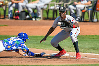 Montrell Marshall (48) of the Billings Mustangs waits for a pick-off throw as Mitchell Hanson (43) of the Ogden Raptors dives back towards first base in Pioneer League action at Lindquist Field on August 14, 2016 in Ogden, Utah. Ogden defeated Billings 15-9. (Stephen Smith/Four Seam Images)