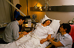 Pregnant woman and husband, she is having drip attached Royal United Hospital Bath Hospital Somerset Dr Richard Leech. She later had a caesarian section. UK 1989 NHS 1980s