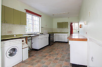 BNPS.co.uk (01202) 558833. <br /> Pic: Cheffins/BNPS<br /> <br /> Pictured: Kitchen. <br /> <br /> The perfect home for a recluse?<br /> <br /> A historic moated farmhouse that has not been sold for half a century is up for auction with a guide price of £600,000.<br /> <br /> Grade II listed Parsonage Farm is an English Heritage scheduled monument and is believed to be built on the site of an iron age fort.<br /> <br /> The house dates back to the 15th century and, having been in the same family for the past 50 years, is now in need of modernisation.<br /> <br /> But once renovated it could be worth £1.2m - double its current price tag.
