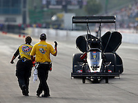 Mar 13, 2015; Gainesville, FL, USA; NHRA safety safari crews stop top fuel driver Cory McClenathan during qualifying for the Gatornationals at Auto Plus Raceway at Gainesville. Mandatory Credit: Mark J. Rebilas-