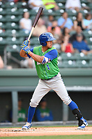 Shortstop Angelo Castellano (1) of the Lexington Legends bats in a game against the Greenville Drive on Friday, June 30, 2017, at Fluor Field at the West End in Greenville, South Carolina. Lexington won, 17-7. (Tom Priddy/Four Seam Images)
