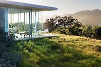 Carex pansa, sedge meadow lawn substitute groundcover around glass home with California native plant garden, Santa Barbara,