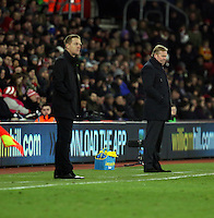 Pictured L-R: Swansea manager Garry Monk and Southampton manager Ronald Koeman Sunday 01 February 2015<br />