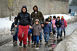 Fathers walk their children home from the Nasa Radost preschool in Smederevo, Serbia. The families, all Roma, live in the Krivac Roma Settlement--one of the largest Roma neighborhoods in the region. The preschool's work is supported by Church World Service.