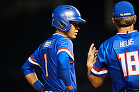 Kevin Vargas (1) of International Baseball Academy in La Mareas de Salinas, Puerto Rico talks with Wes Helms (18) during the Under Armour All-American Game presented by Baseball Factory on July 29, 2017 at Wrigley Field in Chicago, Illinois.  (Mike Janes/Four Seam Images)