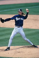 PEORIA, AZ - Randy Johnson of the Seattle Mariners pitches during a spring training game at the Peoria Sports Complex in Peoria, AZ in 1998.  Photo by Brad Mangin