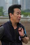 APR 25,2015:Hideaki Fujiwara,trains Staphanos,is interviewed for the Audemars Piguet Queen Elizabeth 2nd Cup at Sha Tin in New Territories,Hong Kong. Kazushi Ishida/ESW/CSM