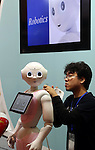 July 21, 2016, Tokyo, Japan - Japanese communication giant Softbank's humanoid robot Pepper gets a maintenace from a robot creator Wataru Yoshizaki of Asratec at Softbank's two-day convention Softbank World in Tokyo on Thursday, July 21, 2016. Softbank CEO Masayoshi Son delivered a keynote speech at the event after the company announced to acquire British chip maker ARM last week.     (Photo by Yoshio Tsunoda/AFLO) LWX -ytd-