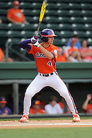 Shortstop Eli White (4) of the Clemson Tigers bats in a game against the Furman Paladins on Tuesday, May 12, 2015, at Fluor Field at the West End in Greenville, South Carolina. Clemson won, 23-15. (Tom Priddy/Four Seam Images)