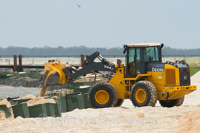 Heavy equipment building sand-filled barricades along the shoreline of Mobile Bay in response to teh BP oil spill. Baldwin County, Alabama. June 2010.