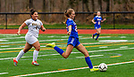WOODBURY, CT-111120JS13 —Nonnewaug's Fiona Gengenback (22) fires in a goal as Wolcott Tech's Phoenix Fields (8) trails the play during their game Wednesday at Nonnewaug High School. <br /> Jim Shannon Republican-American