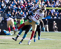 The Carolina Panthers played the San Francisco 49ers at Bank of America Stadium in Charlotte, NC in the NFC divisional playoffs on January 12, 2014.  The 49ers won 23-10.  San Francisco 49ers wide receiver Michael Crabtree (15), Carolina Panthers cornerback Melvin White (23)