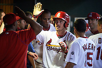 Springfield Cardinals third baseman Patrick Wisdom (5) congratulated by teammates after hitting a home run during a game against the Frisco RoughRiders  on June 3, 2015 at Hammons Field in Springfield, Missouri.  Springfield defeated Frisco 7-2.  (Mike Janes/Four Seam Images)