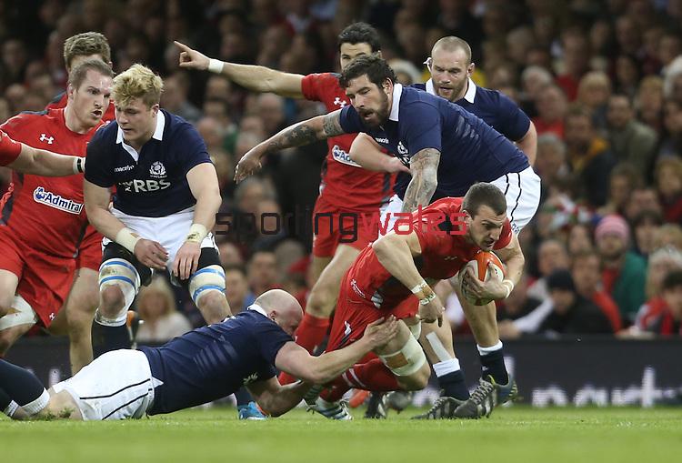 Scotland hooker Scott Lawson tackles Wales captain Sam Warburton.<br /> RBS 6 Nations 2014<br /> Wales v Scotland<br /> Millennium Stadium<br /> <br /> 15.03.14<br /> <br /> ©Steve Pope-SPORTINGWALES